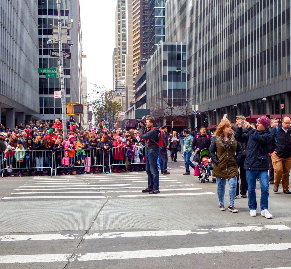 photographer in the middle of the street during the macys thanksgiving day parade