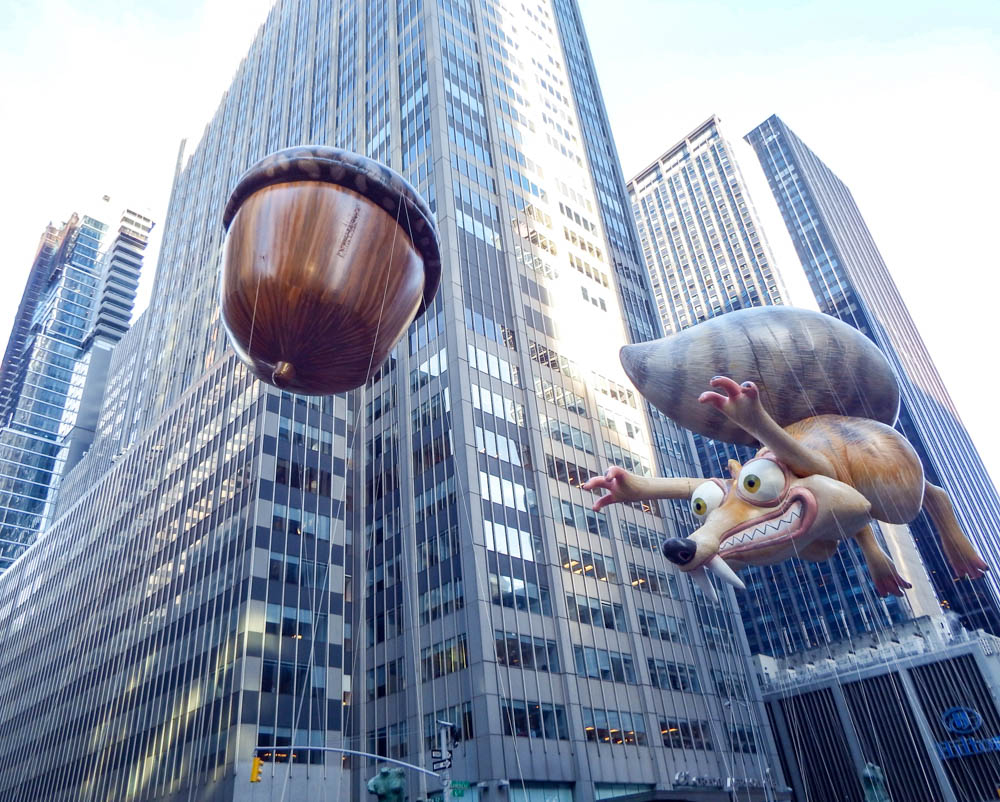 Ice Age squirrel and acorn balloons at the macys thanksgiving day parade
