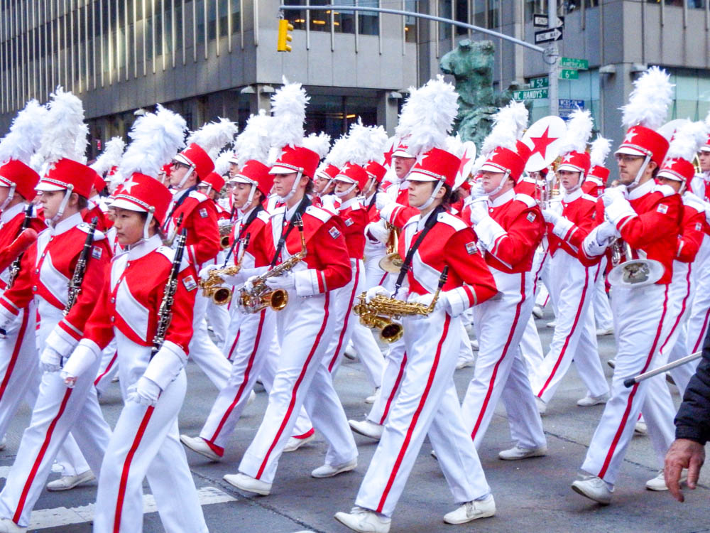 marching band in red and white uniforms