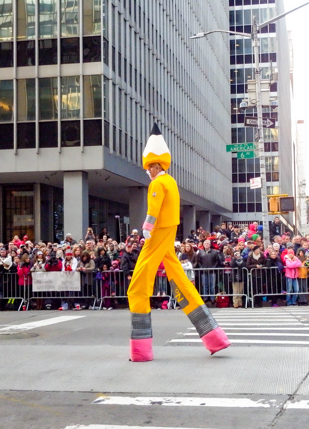 man dressed in a giant pencil costume at the macys thanksgiving day parade