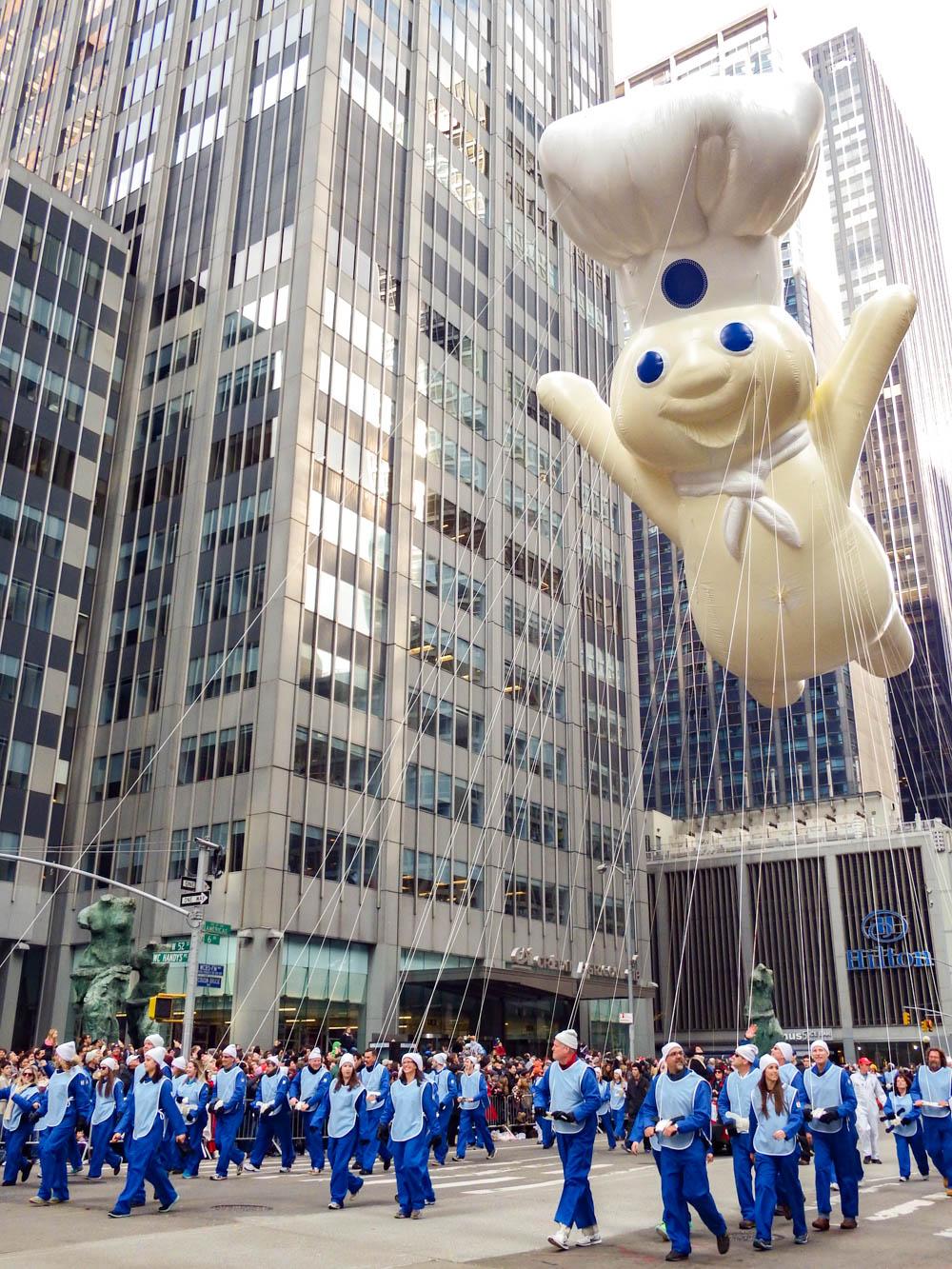 giant pillsbury dough boy balloon at the macys thanksgiving day parade