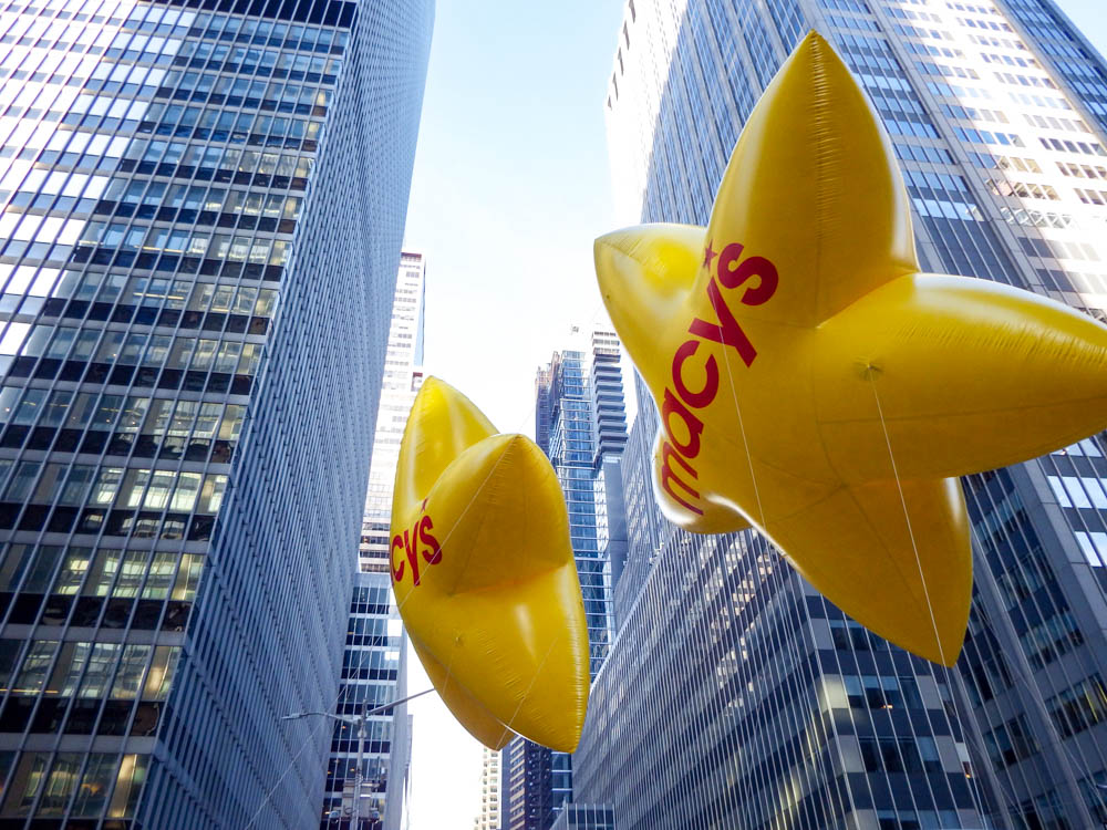 two yellow star-shaped Macy's balloons