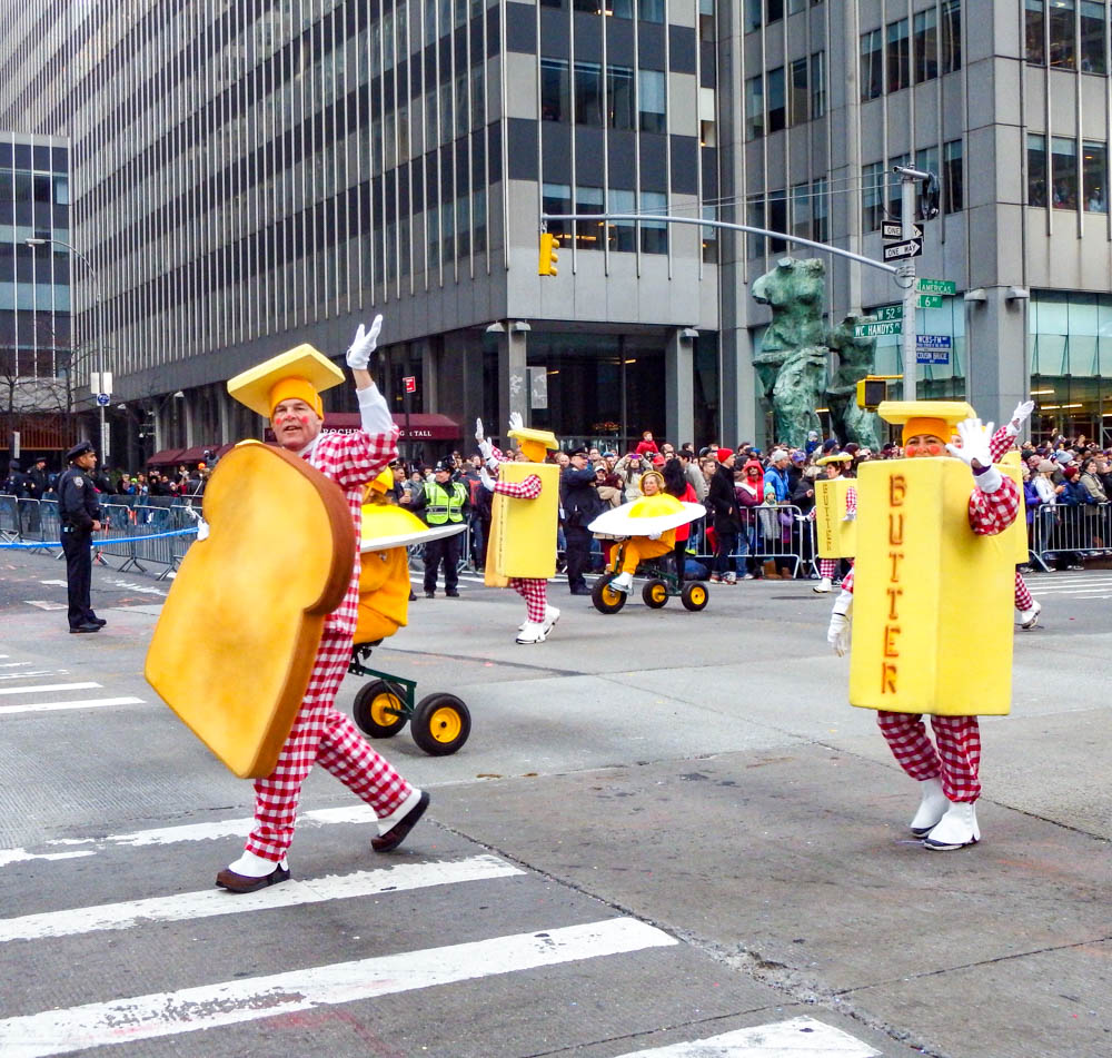clowns dressed as toast and butter at the macys thanksgiving day parade