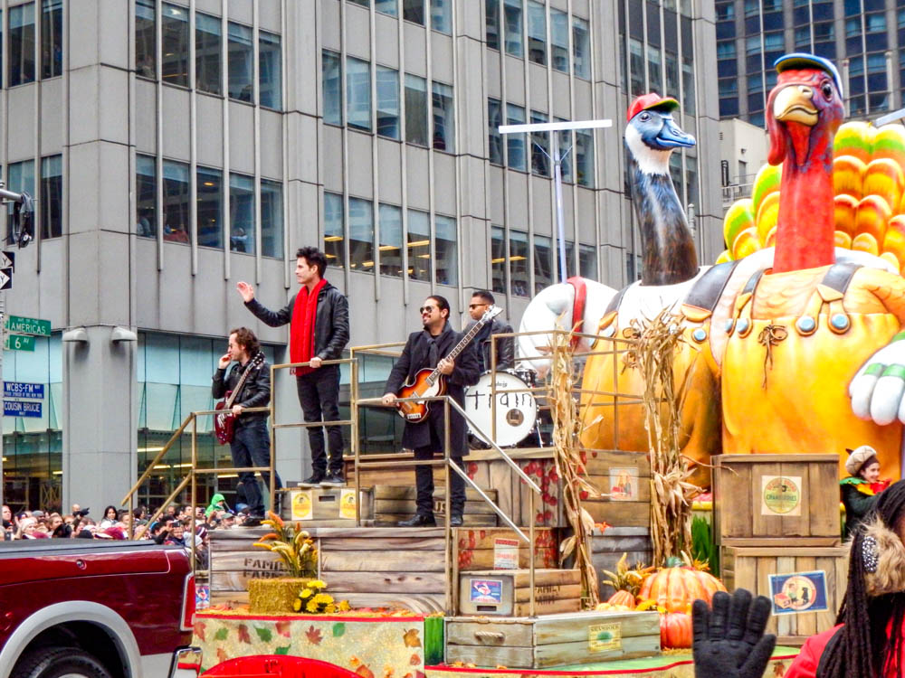 the band Train aboard a macy's parade float