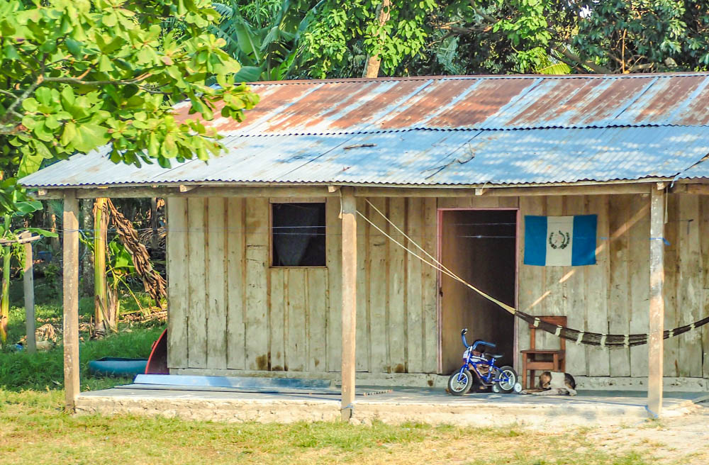 shack with a guatemala flag on it on belize to tikal day trip