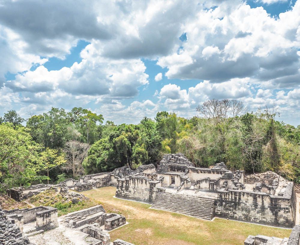 ancient ruins under big sky on sunny day on belize to tikal day trip