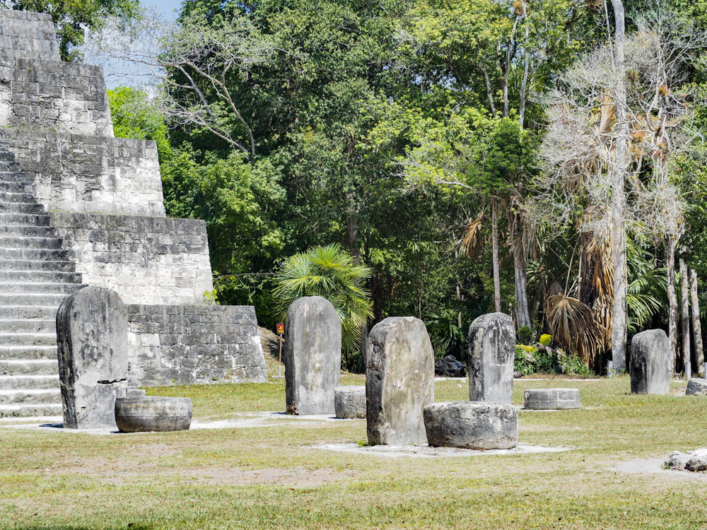 gravestone shaped stones in front of ancient temple