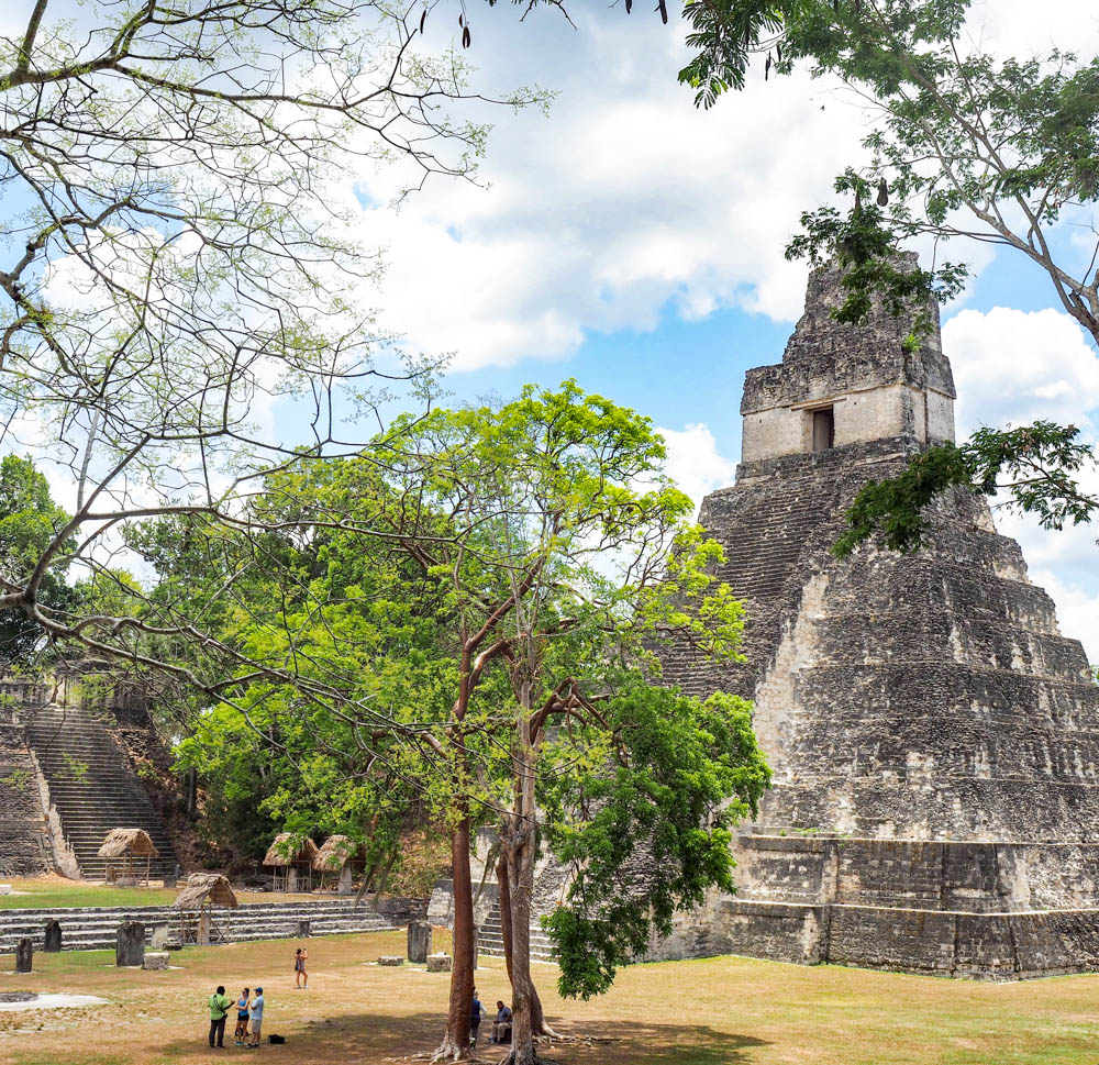 ancient temple seen through the trees on belize to tikal day trip