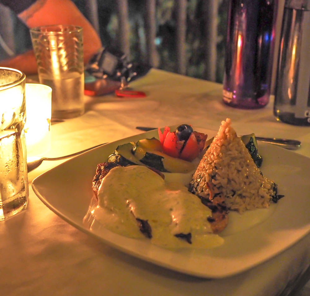 plate of food in candlelight at black rock lodge