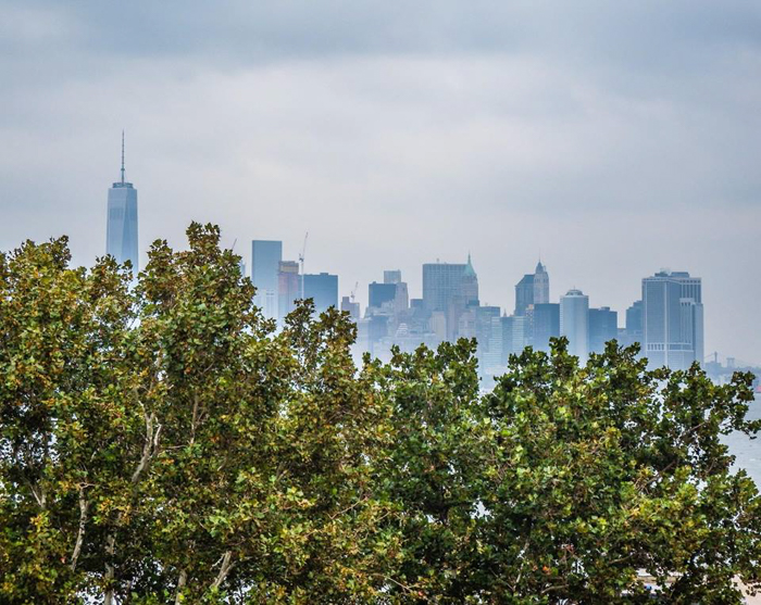 9/11 Museum and Memorial // a photo of the current downtown Manhattan skyline taken from Liberty Island, New York City