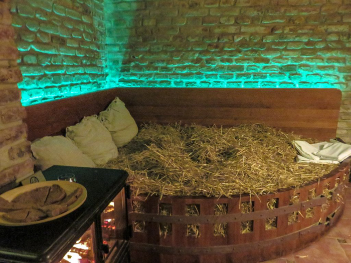 Relaxing wheat straw bed at the Prague beer spa