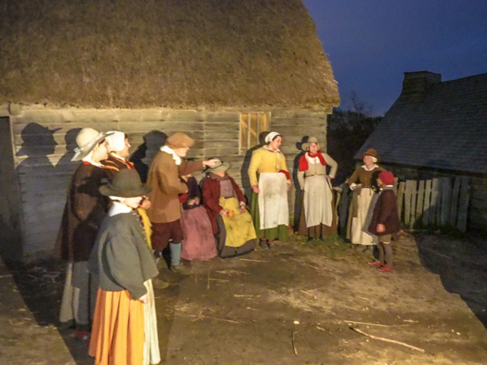 Pilgrims singing at Plymouth Plantation Thanksgiving Dinner in Plymouth, Massachusetts