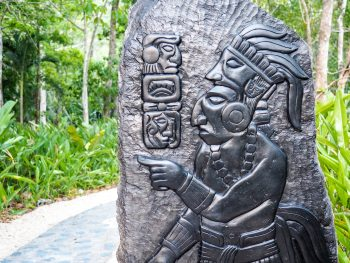 slate carving with maya figures and symbols in belize