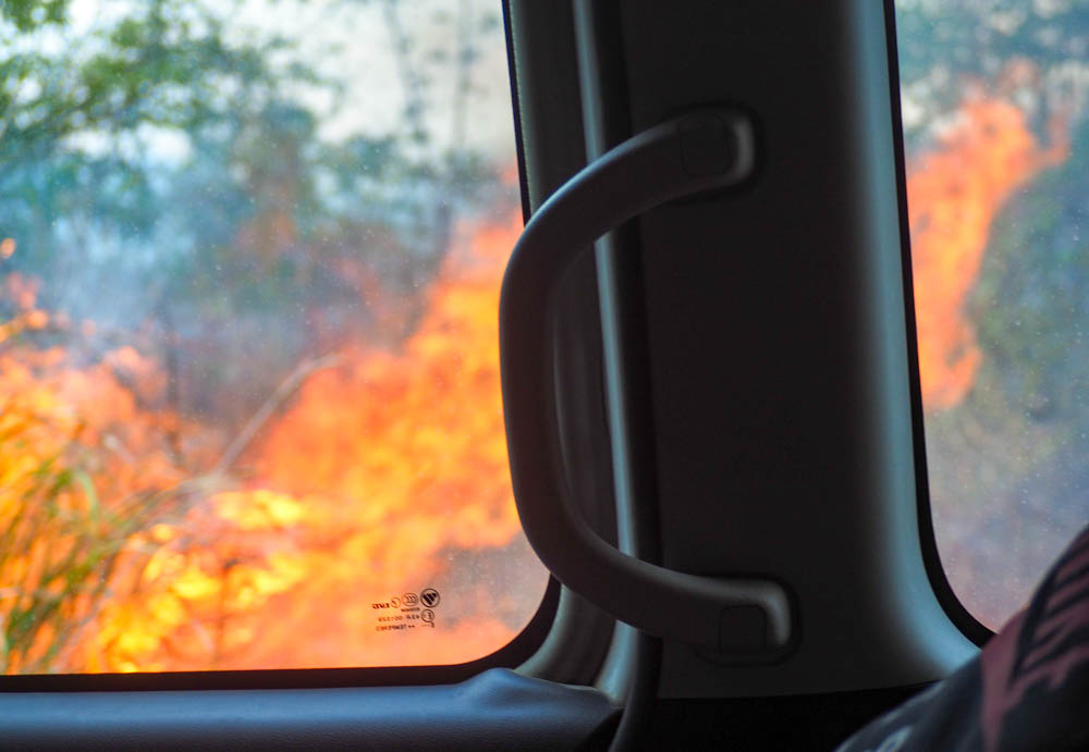 raging wildfire out a car window in belize