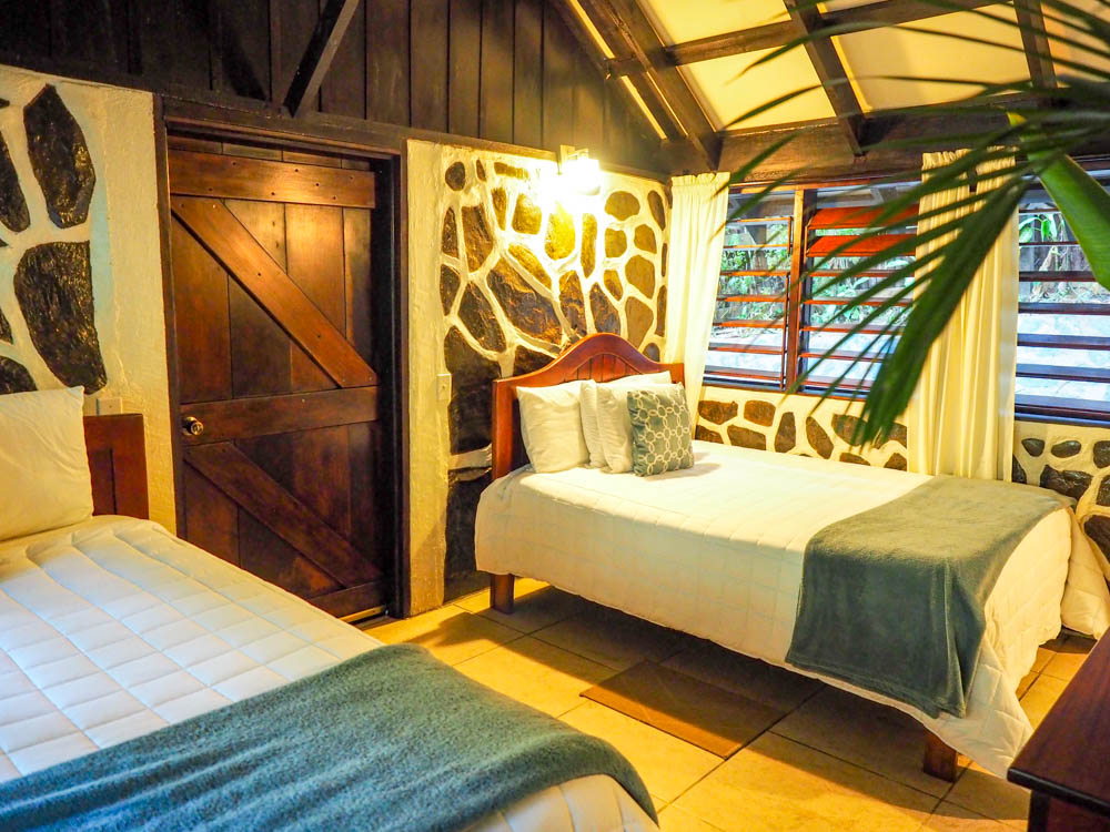 two beds in a jungle cabin in belize
