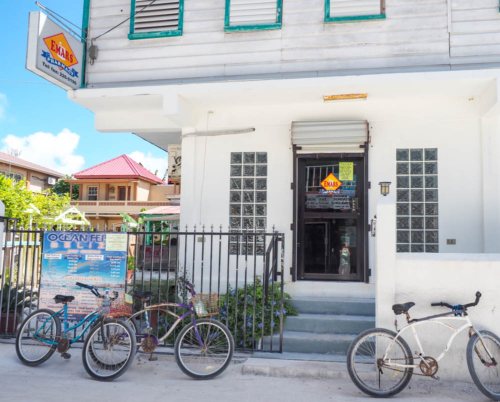 small pharmacy in belize with bikes parked out front