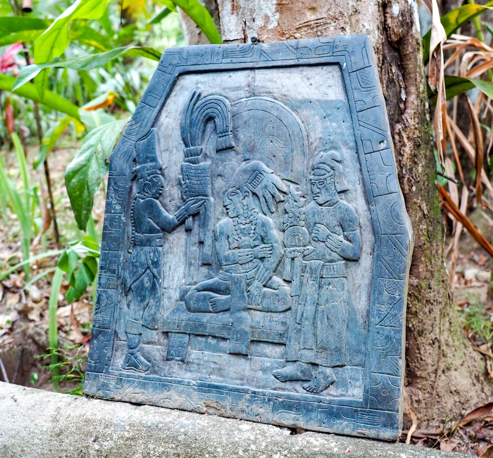slate carving with maya figures in belize