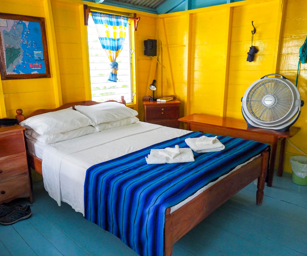 bed inside yellow and teal beach cabana