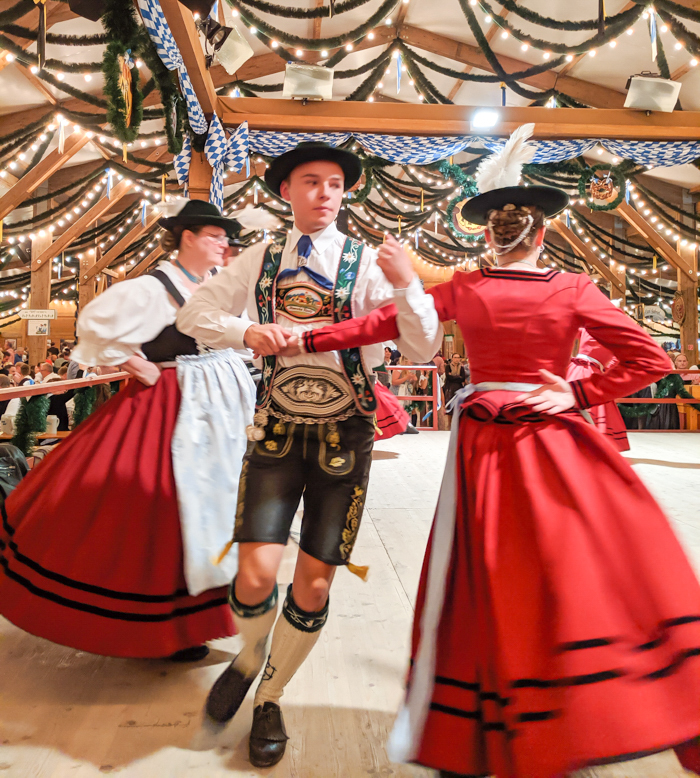 traditional german dancers in the festzelt tradition | How to dress for Oktoberfest, a Complete and Honest Oktoberfest Packing Guide for dirndls | What to wear to Oktoberfest in Munich, Germany #oktoberfest #dirndl #munich #germany #festival #beerfestival #lederhosen