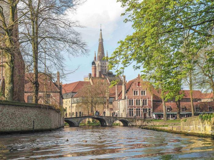 belgium travel guide | Bruges, Belgium | Canal boat ride, bridge, church, medieval architecture