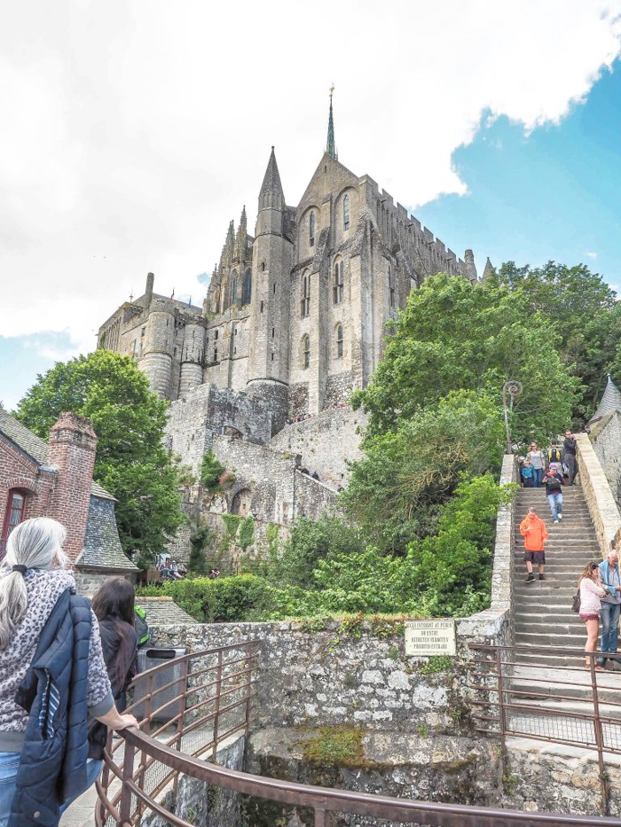 It's actually worth visiting Mont Saint Michel | Normandy, France | Medieval abbey on an island | Bucket list | Disney fairy tale castle inspiration | Mont-St-Michel | stairs