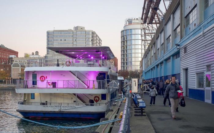 Yacht docked, lit up in pink lights