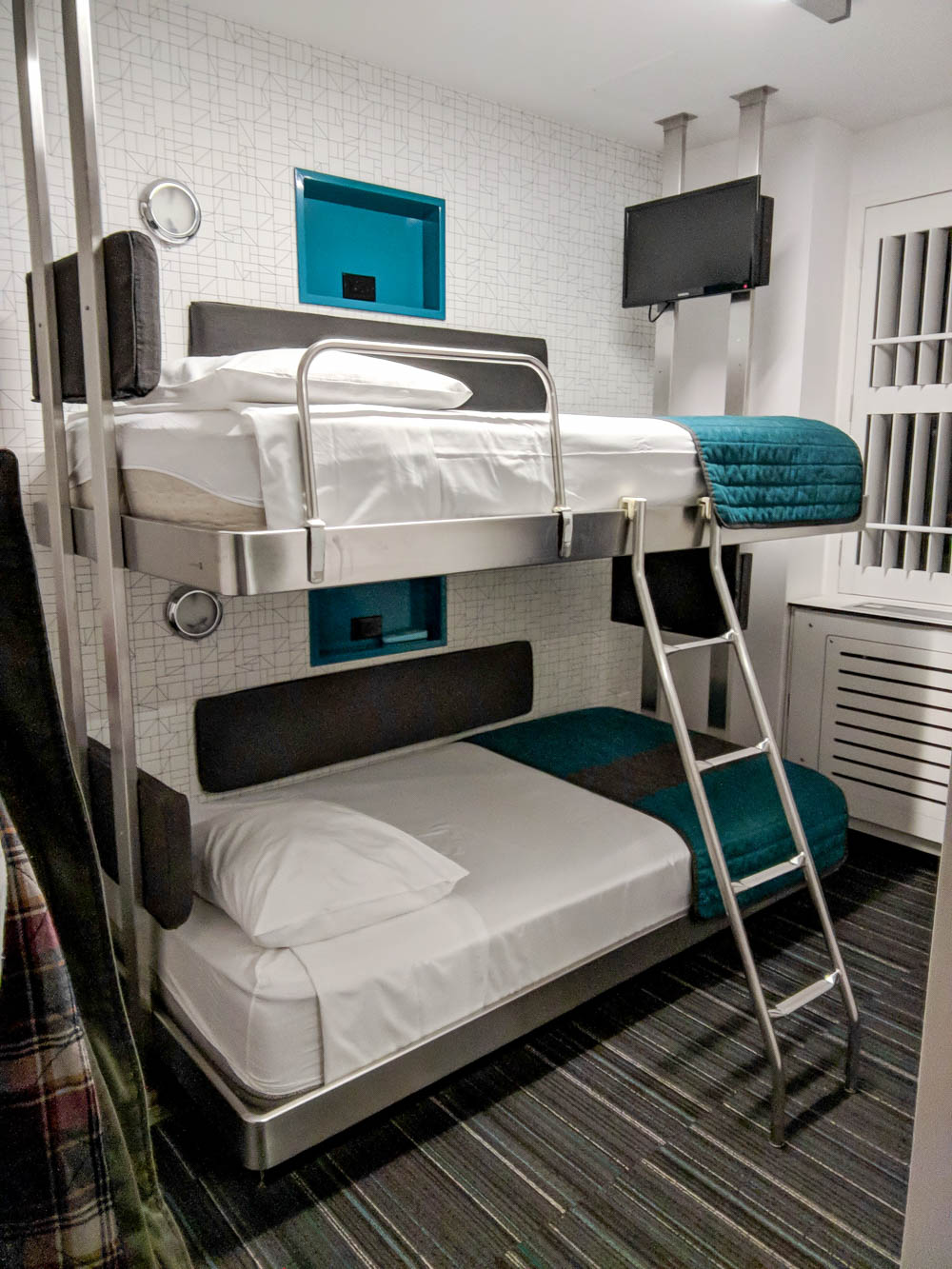 bunk beds in a tiny room