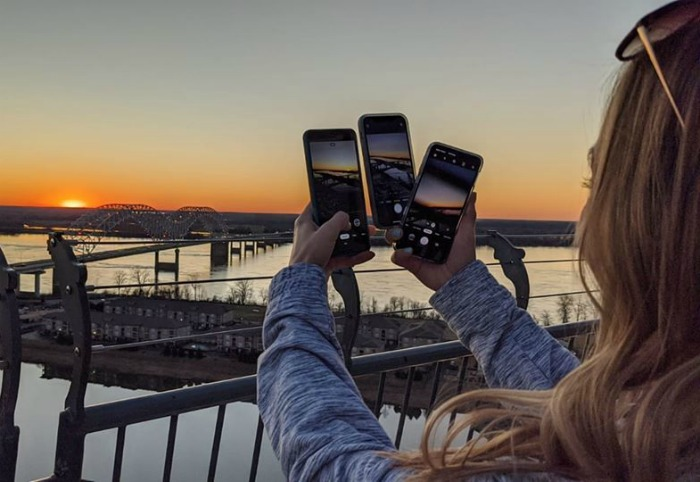 Taking pictures of the Mississippi River bridge from the Lookout at the Pyramind | 200 things to do in Memphis, Tennessee for first-time visitors - a local's guide #memphis #tennessee #mississippiriver #sunset #goldenhour #traveltips