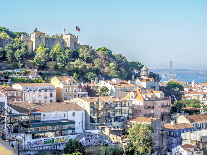 A First-Timer's Guide to Spending 3 Days in Lisbon, Portugal | What to do in Lisbon, what to see in Lisbon | UNESCO World Heritage Sites, museums, where to eat in Lisbon | How to spend 3 days in Lisbon | Castelo de Sao Jorge from Miradouro de nostra senhora do monte #traveltips #lisbon #portugal #timebudgettravel #castle