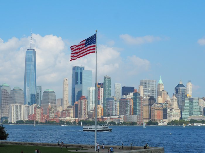 A Time-Budget Traveler's Guide to Visiting Ellis Island in a Hurry | New York City, Manhattan and the Statue of Liberty | United States Immigration Museum | National Park Site #ellisisland #newyorkcity #stateofliberty #nyc #manhattan #ushistory american flag