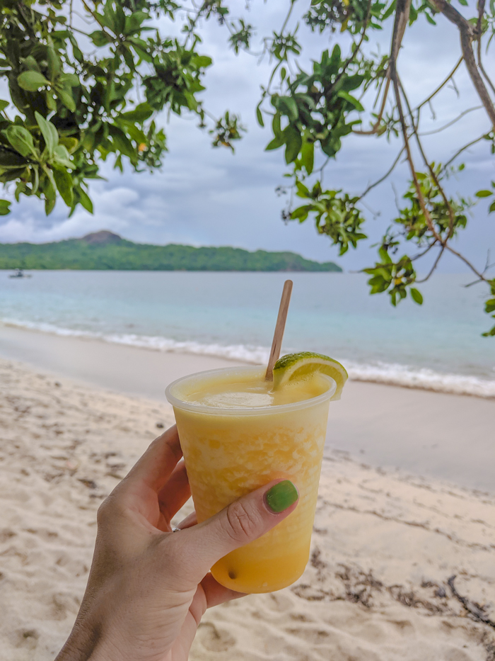 Pineapple daiquiri in Costa Rica, Getting Sick While Traveling Abroad // What to Do and How to Deal | Travel insurance, prepare for getting sick abroad, when to see a doctor, emergency room experience, medicine and medical care abroad, and more. #sickabroad #traveltips #travelguide #healthytravel #healthtips #travelinsurance
