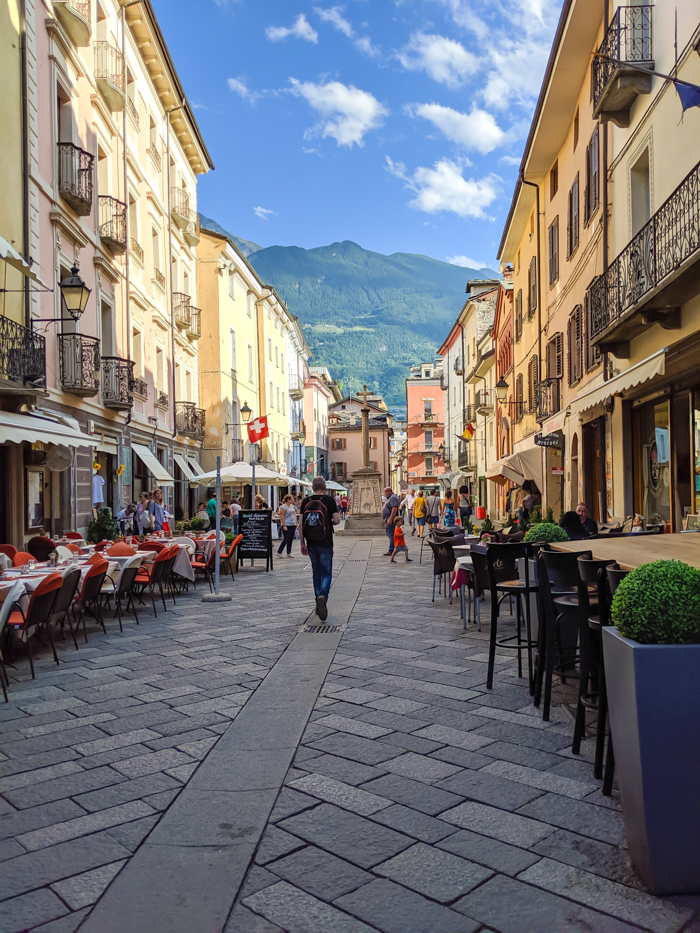 Strolling the streets during Passegiatta   How to Spend 1 Day in Aosta, Italy // The Capital of the Aosta Valley   Things to see in Aosta, Things to do in Aosta, Where to eat in Aosta, the smallest of Italy's 20 regions #aosta #italy #aostavalley #traveltips #timebudgettravel #romanruins #ancient #ruins