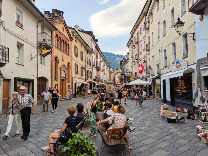 Strolling the streets during Passegiatta | How to Spend 1 Day in Aosta, Italy // The Capital of the Aosta Valley | Things to see in Aosta, Things to do in Aosta, Where to eat in Aosta, the smallest of Italy's 20 regions #aosta #italy #aostavalley #traveltips #timebudgettravel #romanruins #ancient #ruins