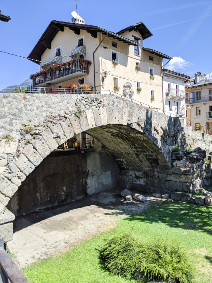 Pont de Pierre, ancient Roman bridge   How to Spend 1 Day in Aosta, Italy // The Capital of the Aosta Valley   Things to see in Aosta, Things to do in Aosta, Where to eat in Aosta, the smallest of Italy's 20 regions #aosta #italy #aostavalley #traveltips #timebudgettravel #romanruins #ancient #ruins