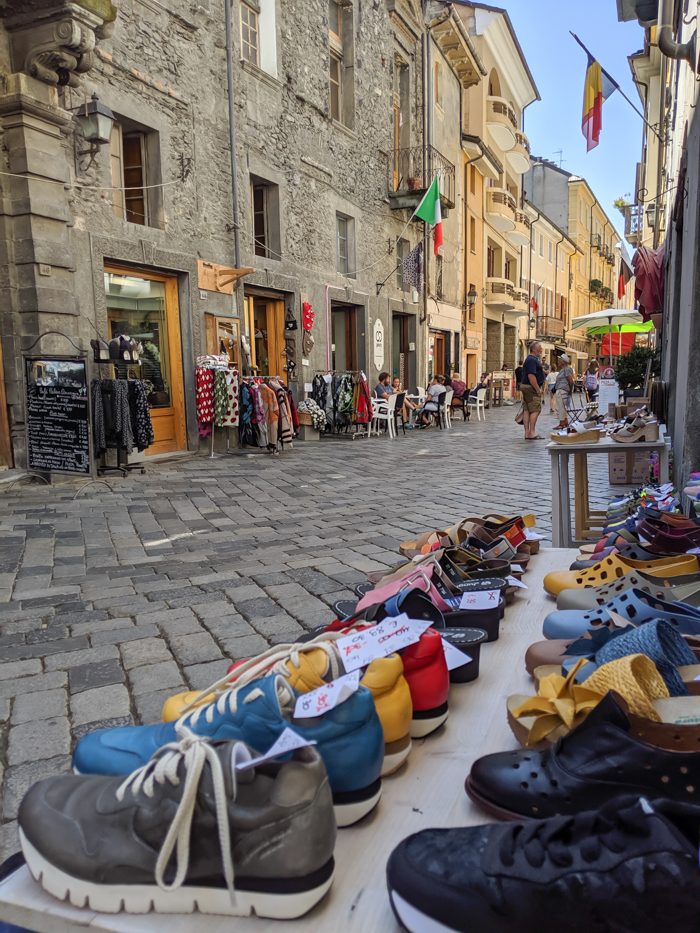 Strolling the streets during Passegiatta, shoe shop   How to Spend 1 Day in Aosta, Italy // The Capital of the Aosta Valley   Things to see in Aosta, Things to do in Aosta, Where to eat in Aosta, the smallest of Italy's 20 regions #aosta #italy #aostavalley #traveltips #timebudgettravel #romanruins #ancient #ruins