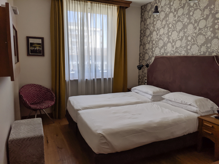 Where to stay in Aosta - the Duca D'Aosta Hotel, bedroom   How to Spend 1 Day in Aosta, Italy // The Capital of the Aosta Valley   Things to see in Aosta, Things to do in Aosta, Where to eat in Aosta, the smallest of Italy's 20 regions #aosta #italy #aostavalley #traveltips #timebudgettravel