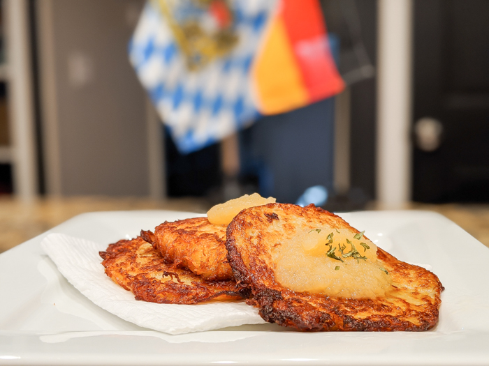 potato pancakes on a plate in front of a german flag