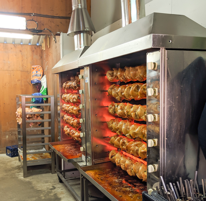 oktoberfest party foods for your oktoberfest-themed party: rotisserie chickens in the lowenbrau beer tent