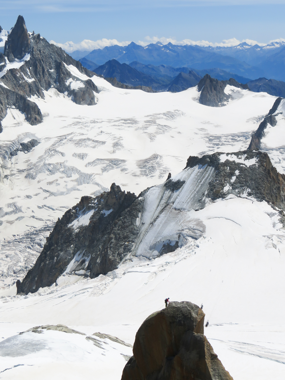 Aiguille du Midi summer visitor's guide, Chamonix, France: lone hiker and Panoramic Mont Blanc cable car to Pointe Helbronner