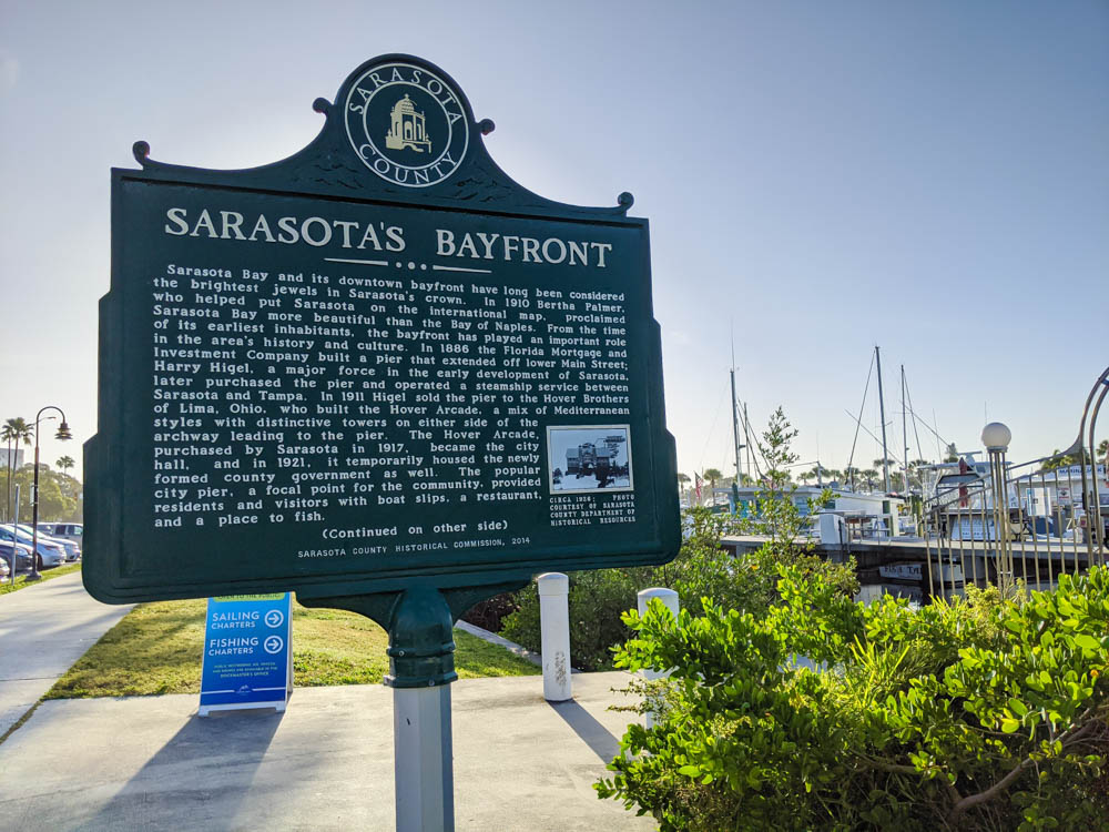 informational sign about the Sarasota bayfront in front of the marina