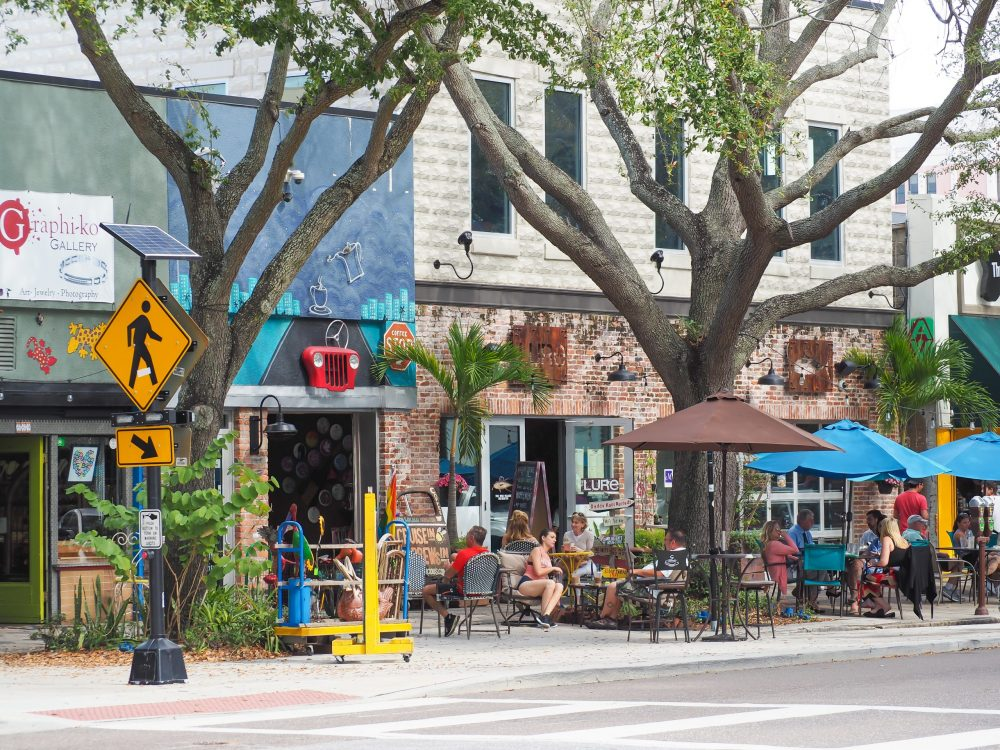 store fronts and large trees in st pete florida