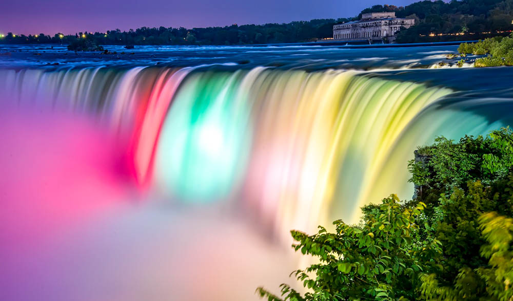 7 of the best niagara falls tours from new york: Niagara Falls lit up at night