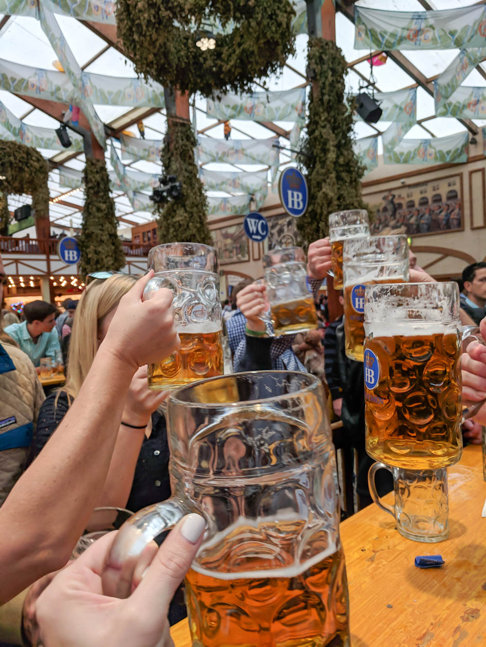 prosting Oktoberfest beers   Will Oktoberfest 2021 take place? Is Oktoberfest 2021 going to be canceled? All the info you need to know like what to do, how to plan ahead, official announcements out of Munich, Germany
