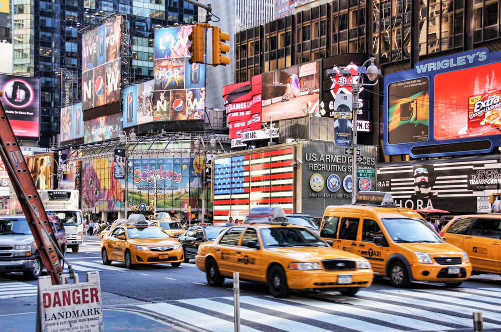 Yellow taxis and signs in New York City's Times Square