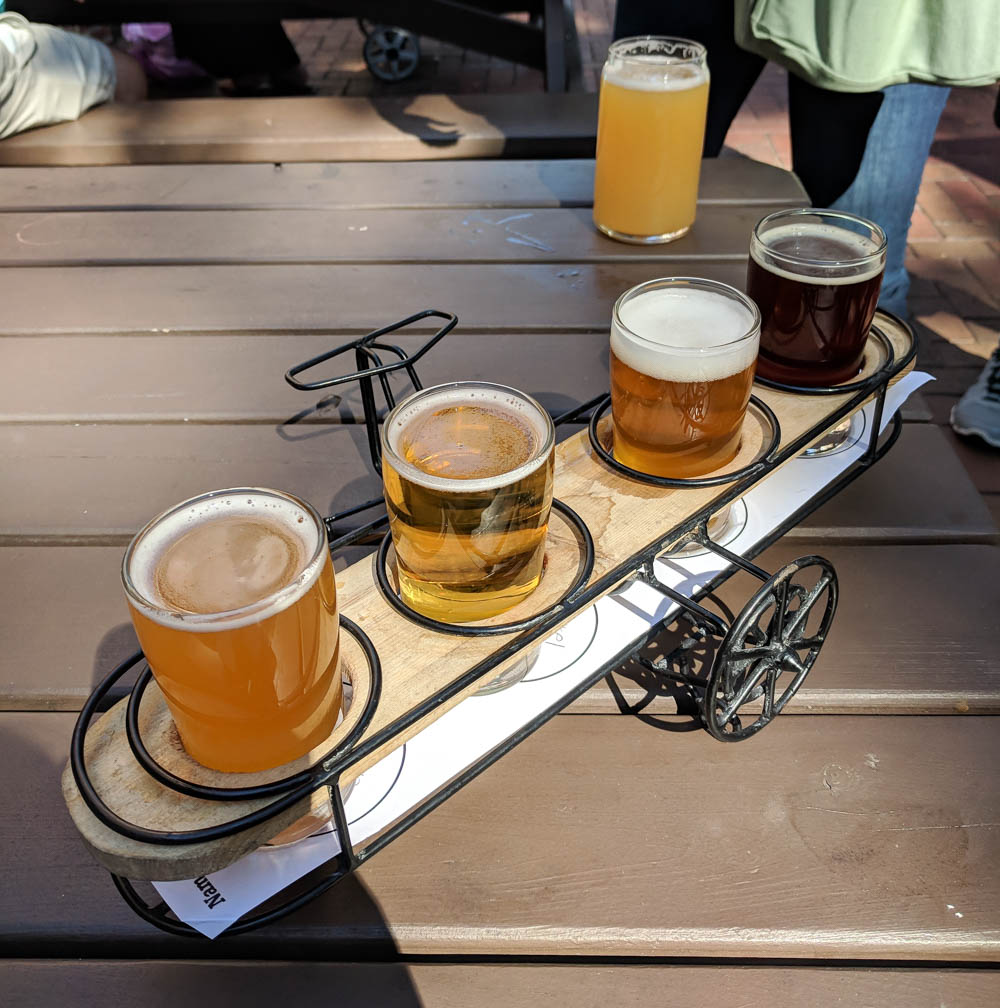 beer samples in an airplane-shaped holder