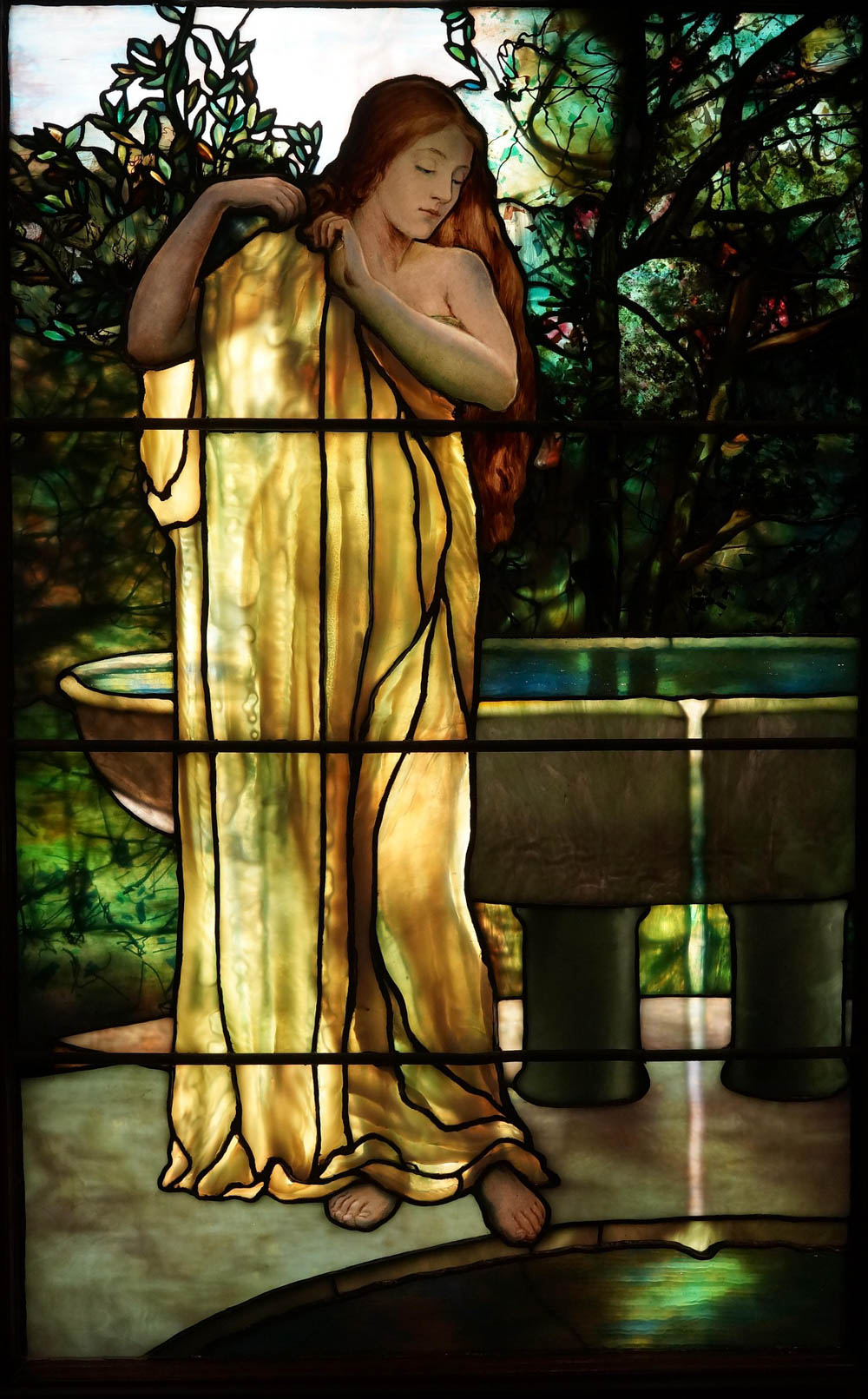 stained glass window of female figure - things to do in orlando besides theme parks