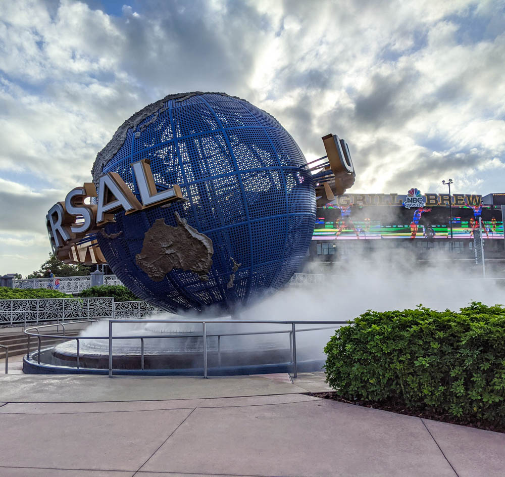 giant Universal Studios globe surrounded by mist - things to do in orlando besides theme parks