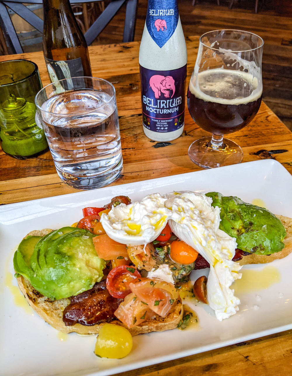 fancy brunch plate and dark beer - things to do in orlando besides theme parks
